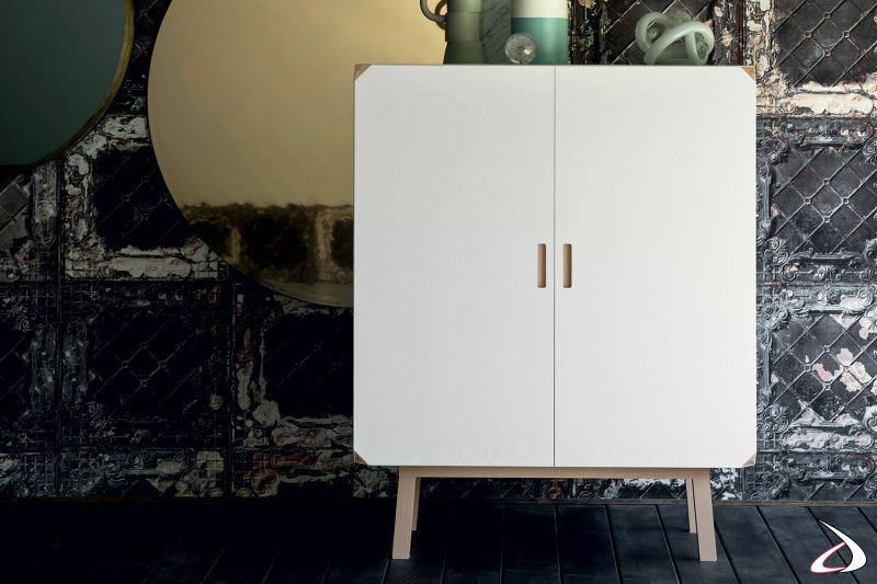Solid white two-door sideboard with high feet and recessed handle