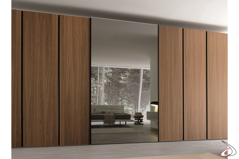 Bedroom closet with sliding doors and a mirror