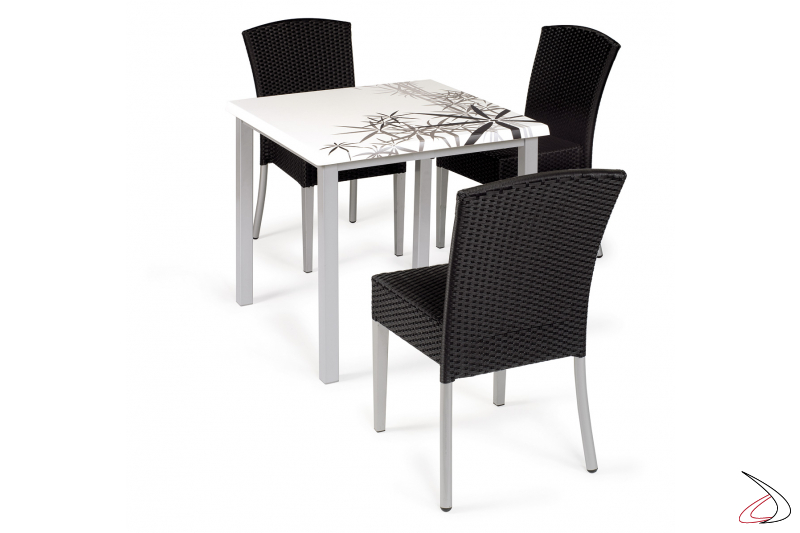 Patio set in synthetic wicker with chairs in charcoal-grey colour