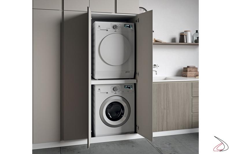Arredo lavanderia moderna con armadio porta lavatrice e asciugatrice a colonna