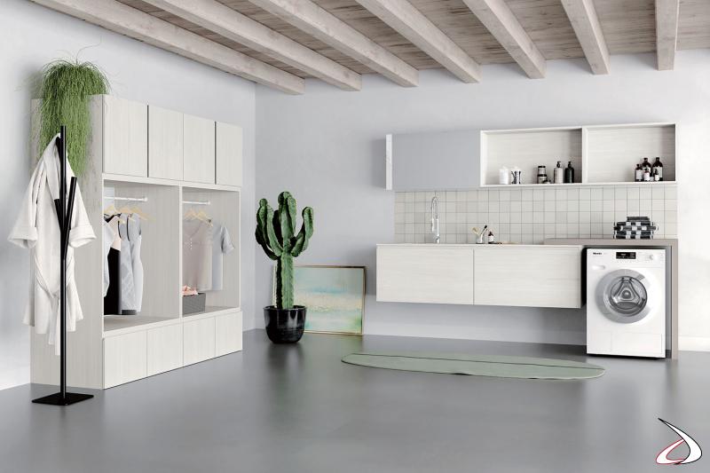 Arredo lavanderia di design su due pareti con lavabo sospeso e armadiatura ordinett a giorno con porta abiti