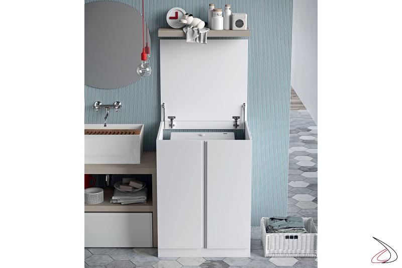 Lavanderia moderna con mobile porta lavatrice con carica dall'alto