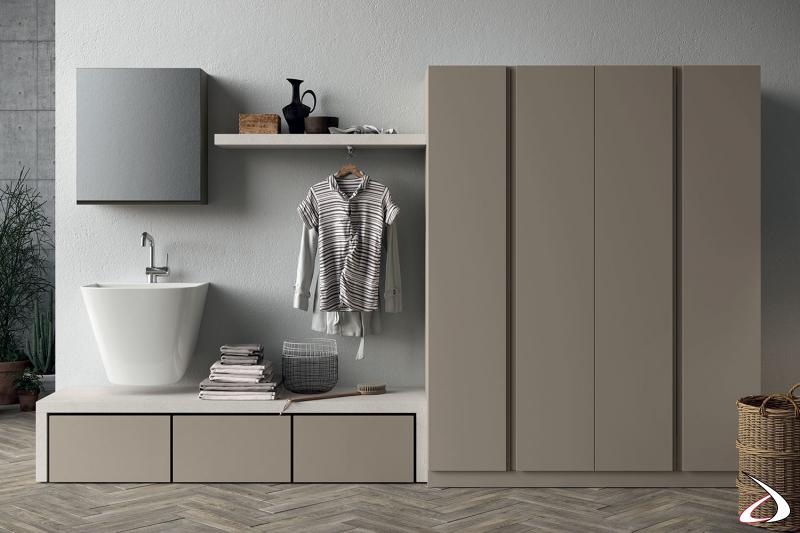 Lavanderia moderno con lavatoio sospeso, panca con cassetti porta biancheria