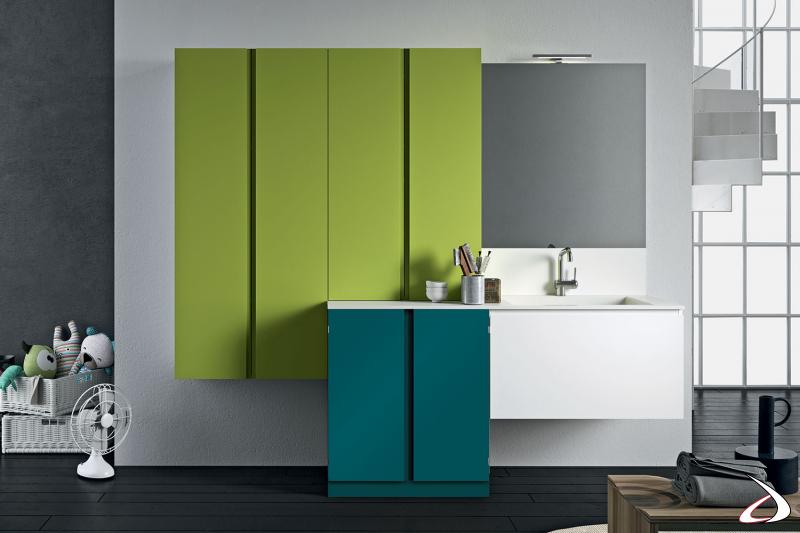 Arredo lavanderia moderno e colorato con mobile porta lavatrice e lavabo grande sospeso