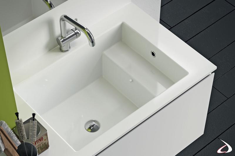 Arredo lavanderia di design con ampio lavabo con porta sapone