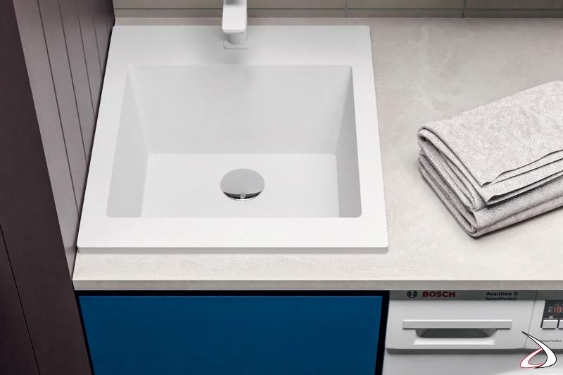 Arredo lavanderia in nicchia moderno con vasca lavatoio in marmo minerale