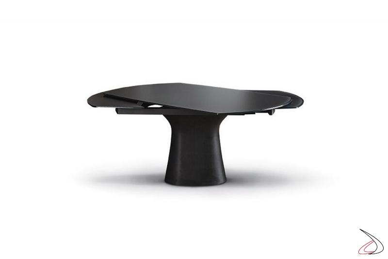 Tavolo design allungabile con sistema di apertura allunghe con rotazione del piano