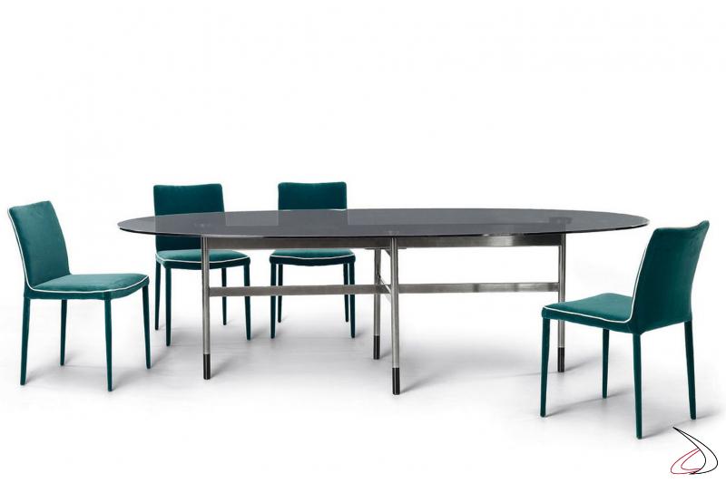 Tavolo moderno ellittico con basamento incrociato