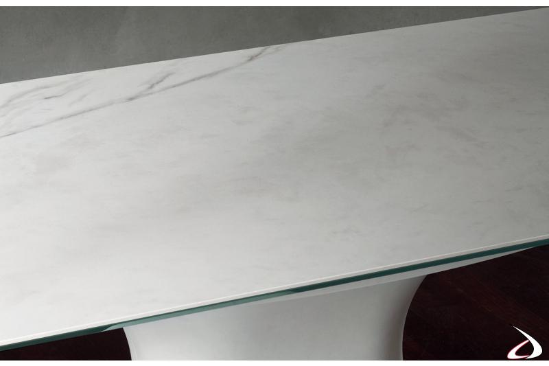 Tavolo di lusso ellittico con piano in supermarmo arabescato