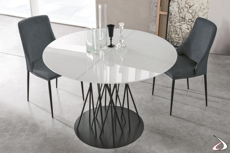 Tavolo rotondo allungabile con basamento centrale e piano in vetro bianco