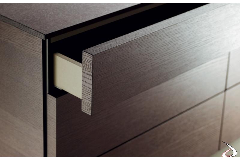 Cassetto con incavo laterale per apertura frontale