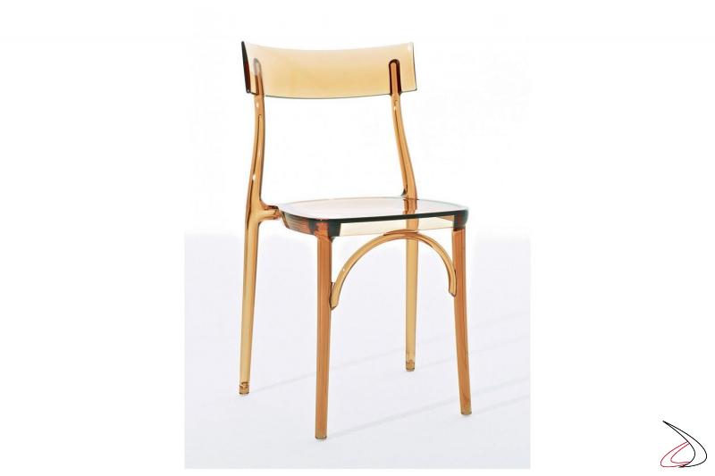 Sedia impilabile in policarbonato trasparente giallo ambra di design da bar
