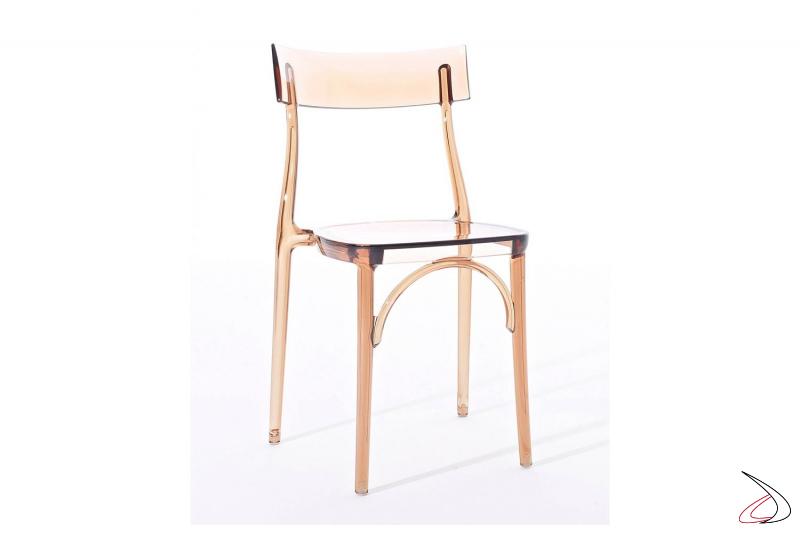 Sedia in policarbonato trasparente giallo ambra di design impilabile