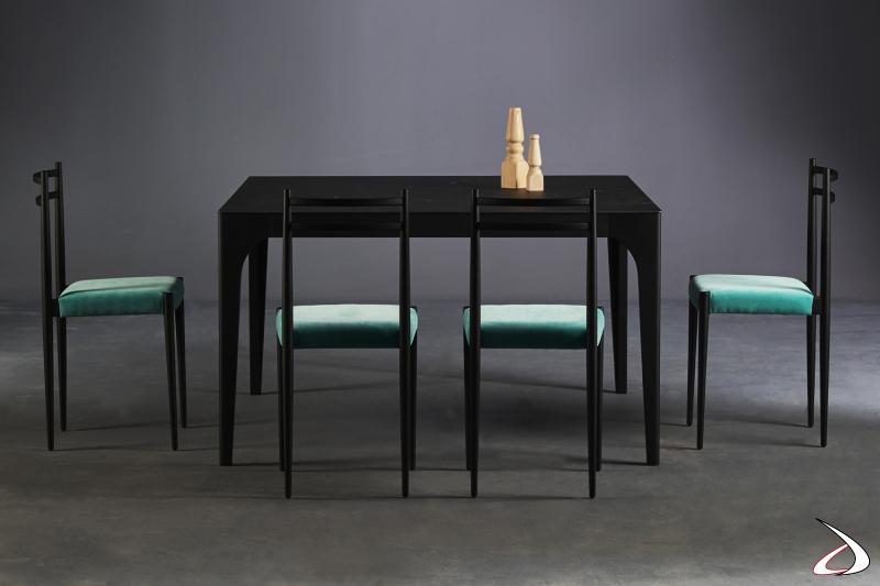 Sedie Giò e tavolo Cargo by Colico.