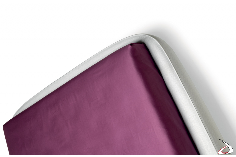 padded bed with bed frame
