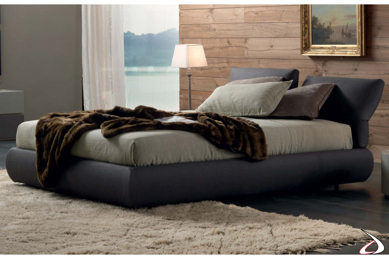 Design bed with padded adjustable headboard