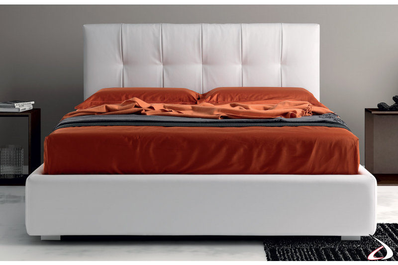 Upholstered bed with container