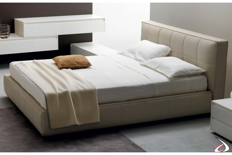 Modern bed upholstered in faux leather with container