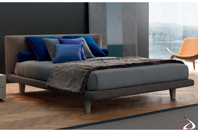 Modern double bed upholstered in fabric