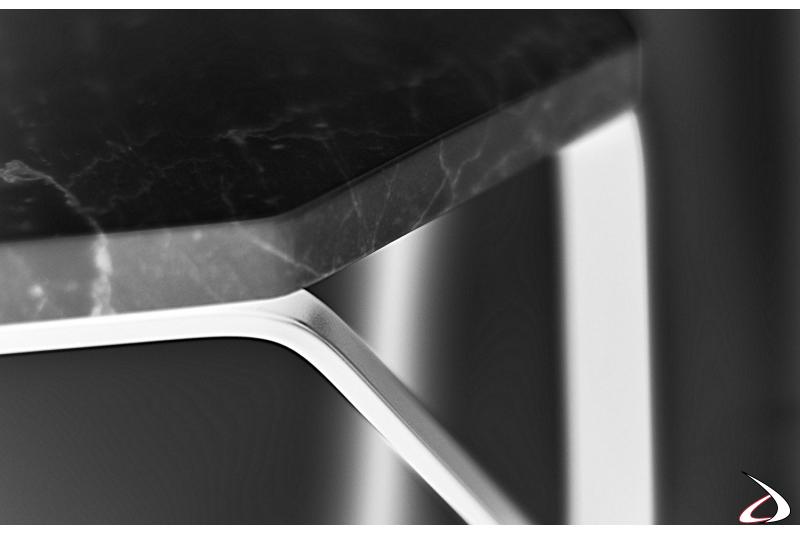 Tavolino di design in acciaio con piano in marmo nero