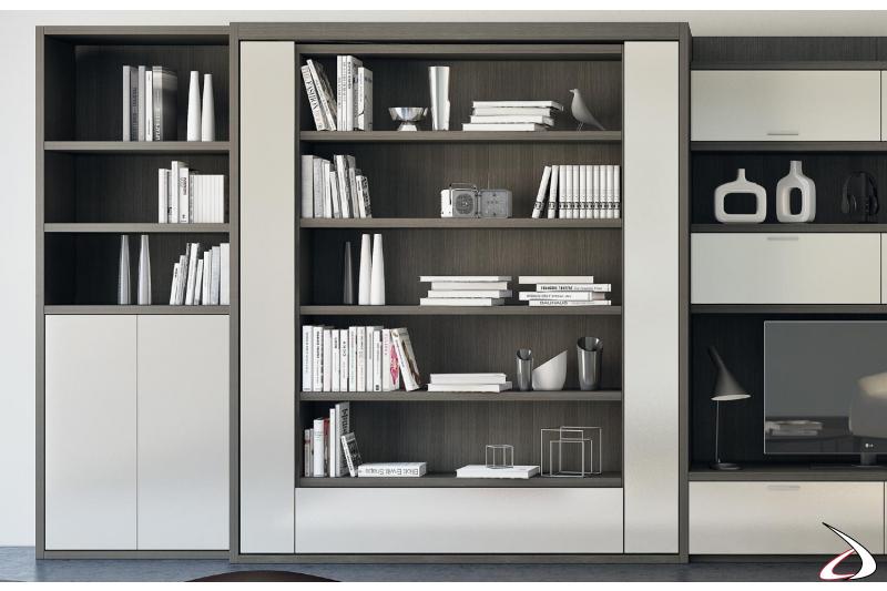 Libreria soggiorno con letto trasformabile girevole