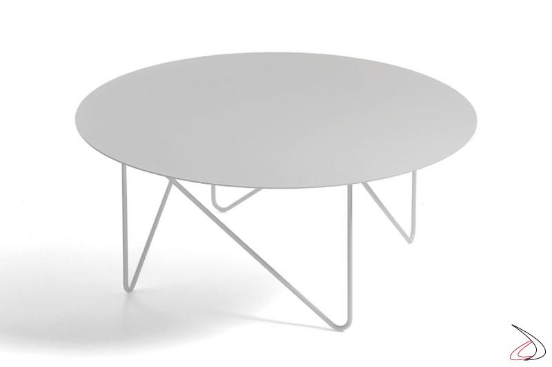 Tavolino rotondo con piano in vetro bianco.