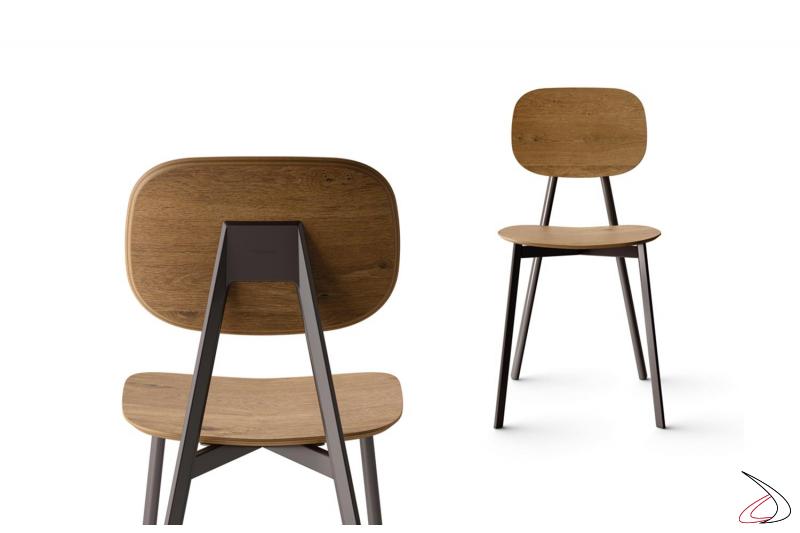 Sedia elegante in impiallacciato con seduta e schienali ellittici e gambe in metallo