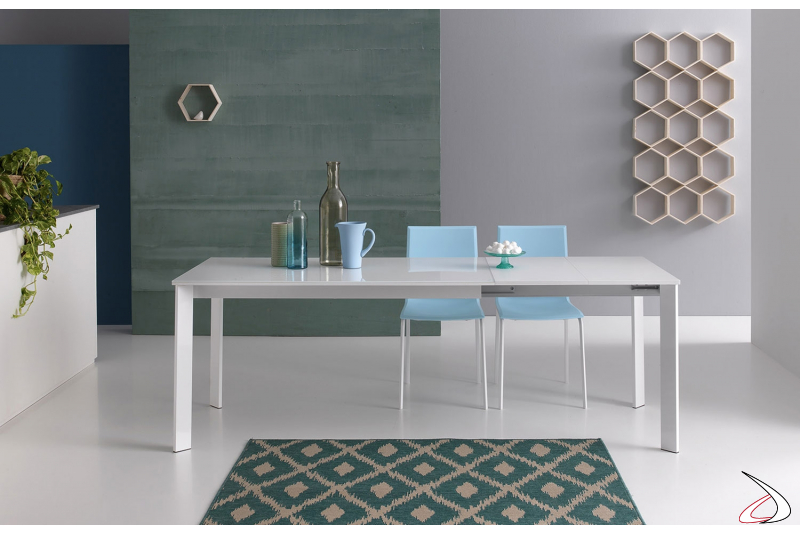 Tavolo allungabile moderno bianco in vetro con due allunghe in melaminico