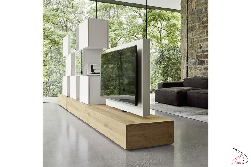 Soggiorno da centro stanza moderno con pannello porta tv girevole