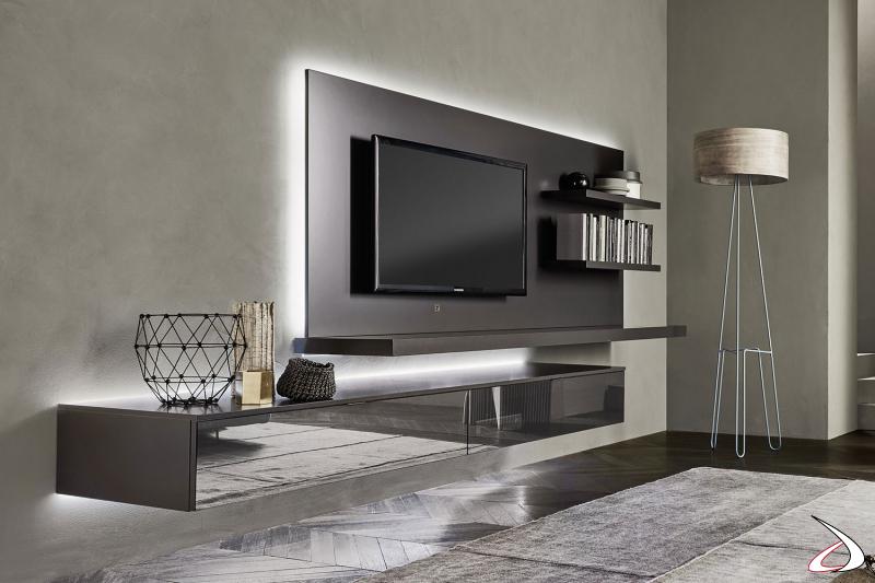 Soggiorno sospeso di design con luci led e pannello tv con mensole