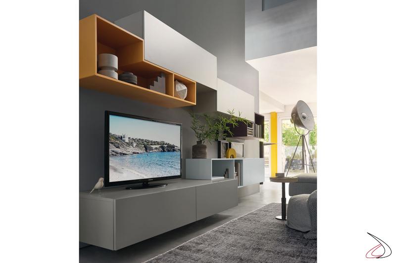 Parete soggiorno componibile moderna con basi porta tv sospese ed elementi sagomati