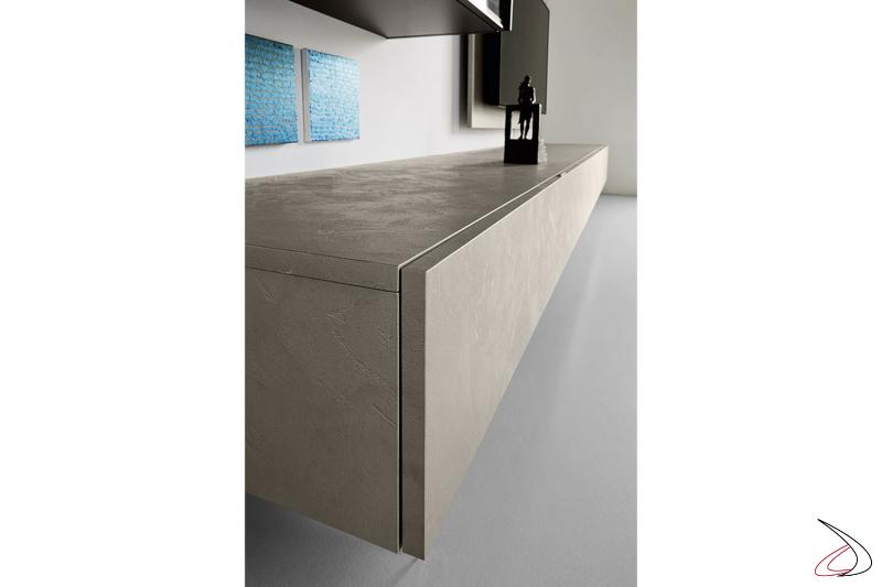 Parete soggiorno di design con basi sospese con effetto cemento
