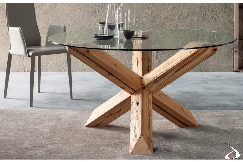 Tavolo di design rotondo con basamento in legno