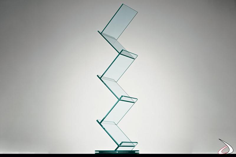 Libreria moderna ed elegante dal design essenziale in vetro con base rotante.