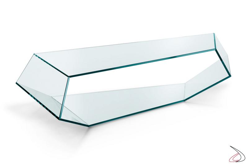 Tavolino in vetro temperato, el design moderno. Le superfici si susseguono dando forma a degli spigoli che creano un arredo elegante e ricercato.