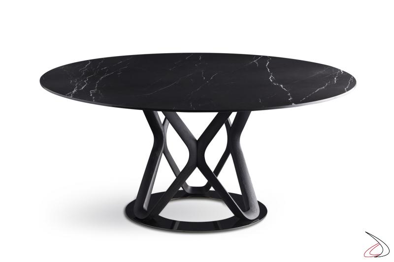 Tavolo rotondo con anello base cromato struttura in legno tinto nero e piano in marmo nero marquinia.