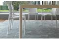 Tavolo di design grande fisso con gambe tubolari in alluminio e piano in lamiera di acciaio