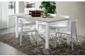 Tavolo moderno allungabile da soggiorno con piano in laminam e gambe bianche