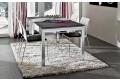 Tavolo soggiorno allungabile con piano in HPL porfido nero e gambe in alluminio