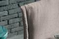 Letto singolo moderno in tessuto con testiera imbottita con risvolti
