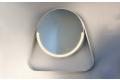 Specchiera rotonda di design in finitura bianca con mensola e retroilluminazione a led