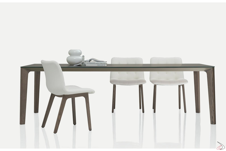 Tavolo da soggiorno per 10 persone in cristallo con gambe in legno massello