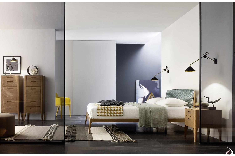 Camera da letto moderna con comodino e settimini